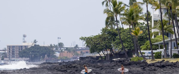 Volcanic rock makes up the majority of the Big Island's shoreline, access to surf  spots can be quite a challenge. Photo: Rock