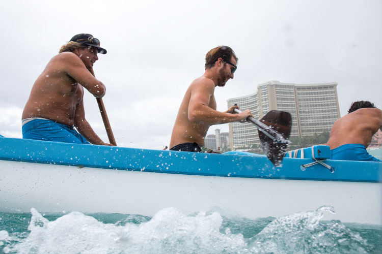 """This is just another day at the office,"" said Zane Aikau (left) steering an outrigger canoe with writer Cash Lambert (middle). Photo: Heff"